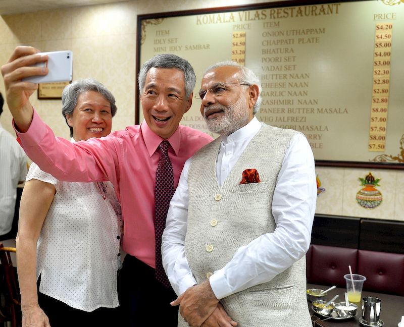 Prime minister Lee Hsien Loong, Ho Ching, and Prime Minister Modi taking a wefie
