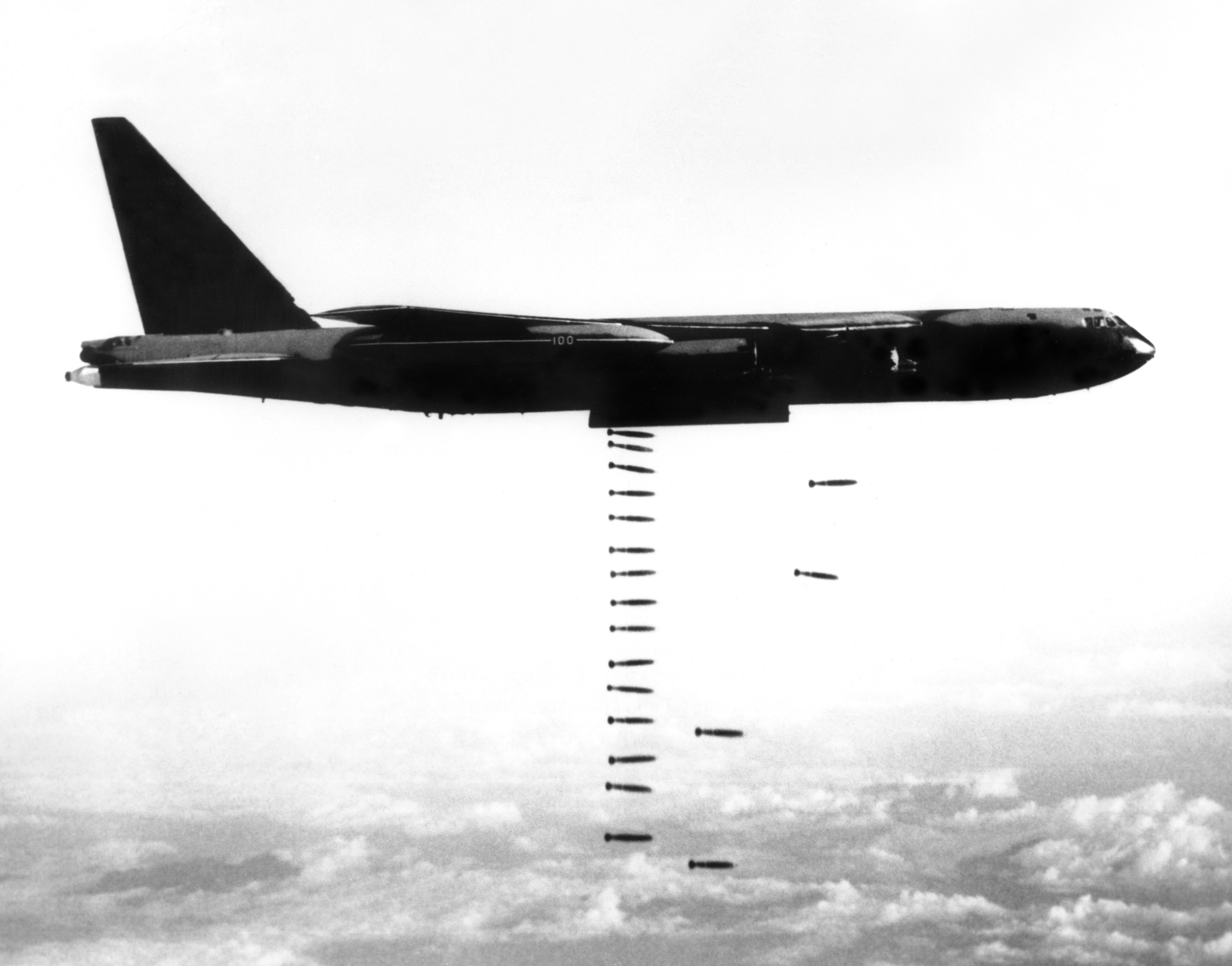 B-52 Stratofortress releasing a 'bomb train' over targets in Vietnam during the Second Indochina War, also known as the Vietnam War.
